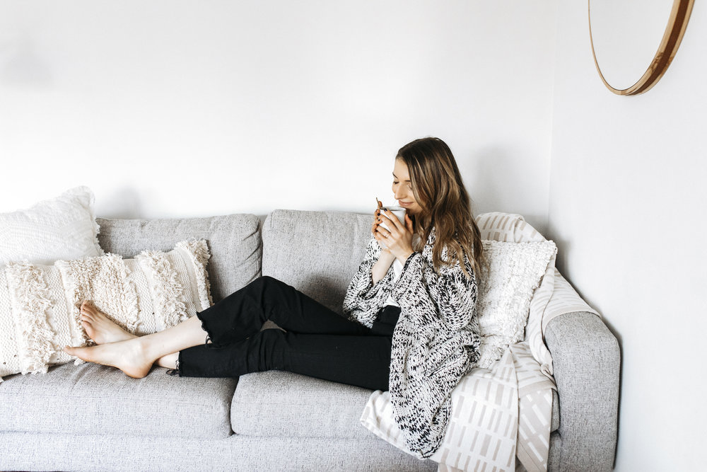 Hygge is about staying cozy and positive. Writer Emily Hess wraps herself in thick blankets and sips on tea to stay warm.