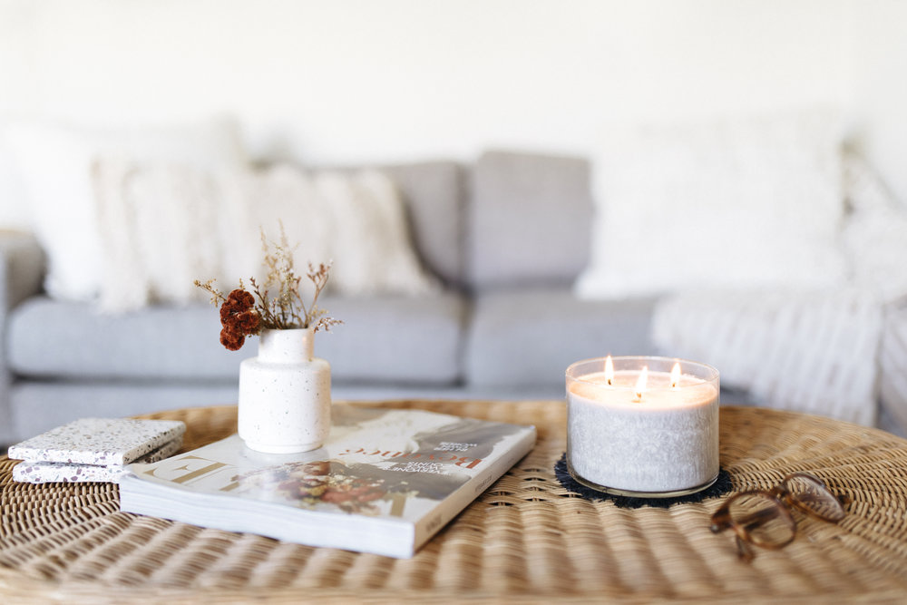Warm lighting and soft candles helps brighten a room and hygge up a house for the winter