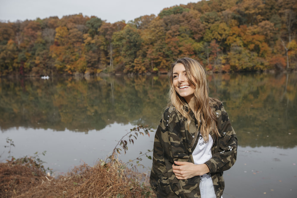 Emily R. Hess smiles in a fall cameo print to stay warm in the bright sun, thinking about gratitude.