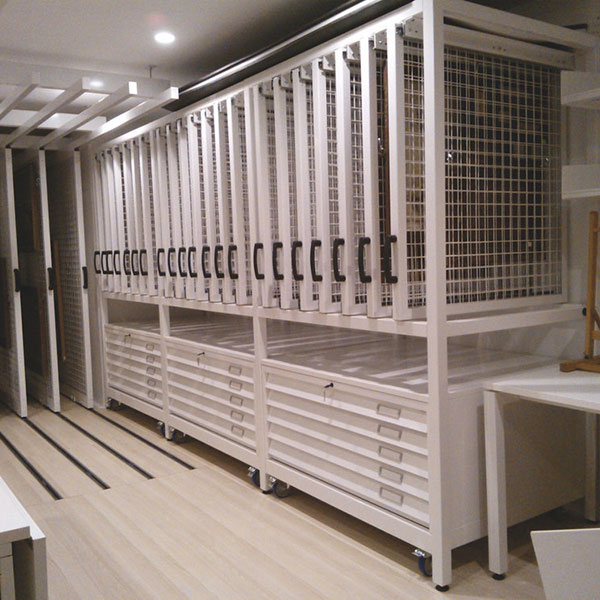 Plan chest storage with custom picture racking