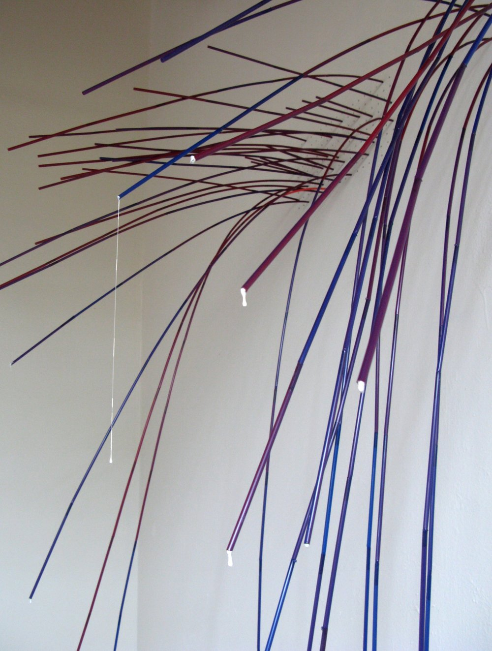 Drip (detail)  Drilled holes in sheetrock wall, drinking straws, house paint, hotmelt glue; installation at Caldera Arts Center, Sisters, OR 12' x 5'x 3'