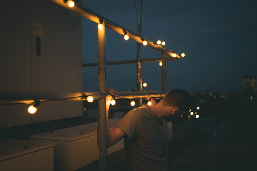 rooftop lifestyle photography night string lights new york