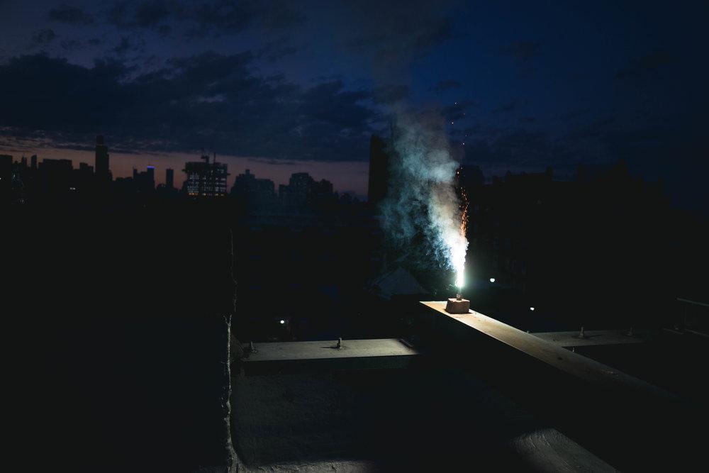 Long exposure firework rooftop brooklyn - robert ravenscroft nyc and austin photographer