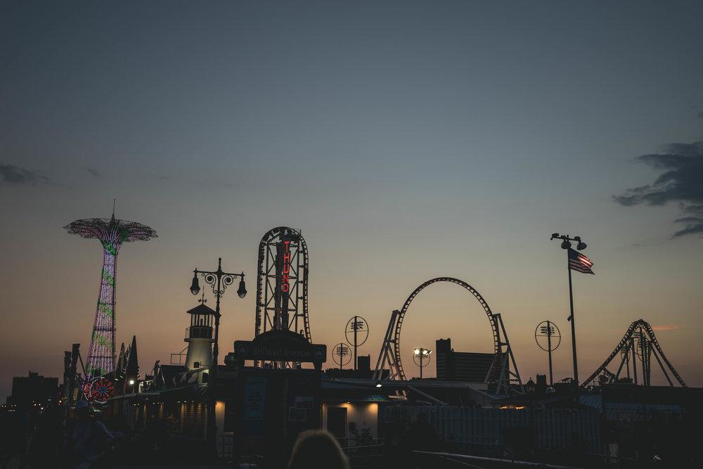 night sunset coney island park rides