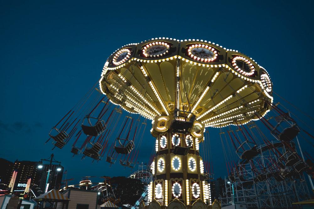 coney island ride lit up at night