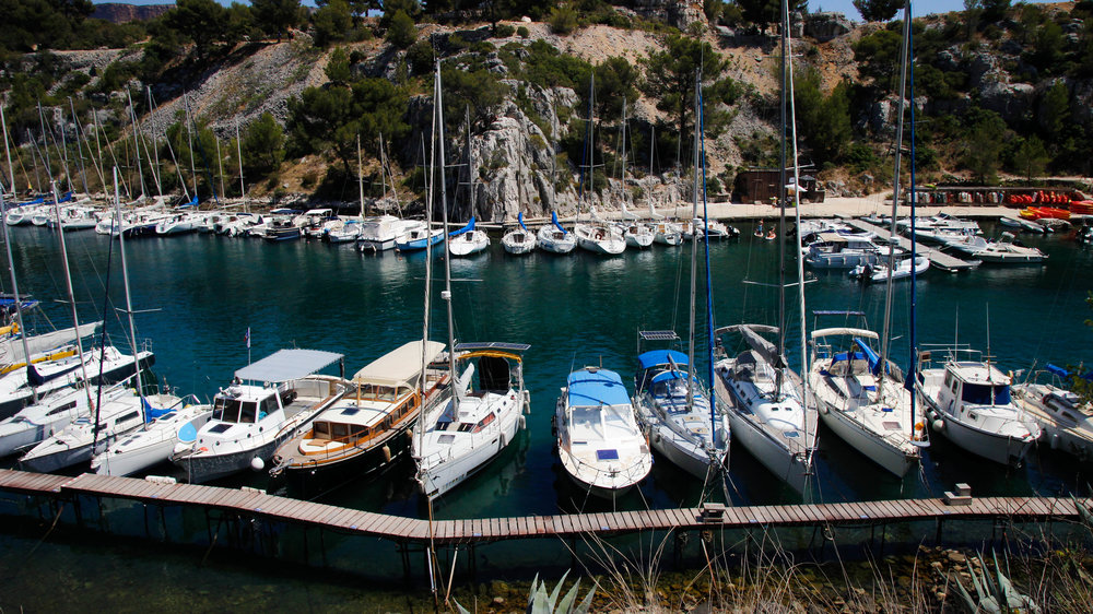 Sailboats lined up in calanques cassis france  shot by robert ravenscroft new york photographer