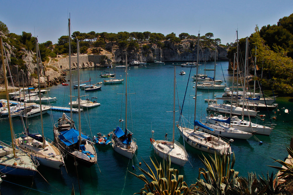 Sailboats lined up in calanques cassis france  shot by robert ravenscroft travel photographer