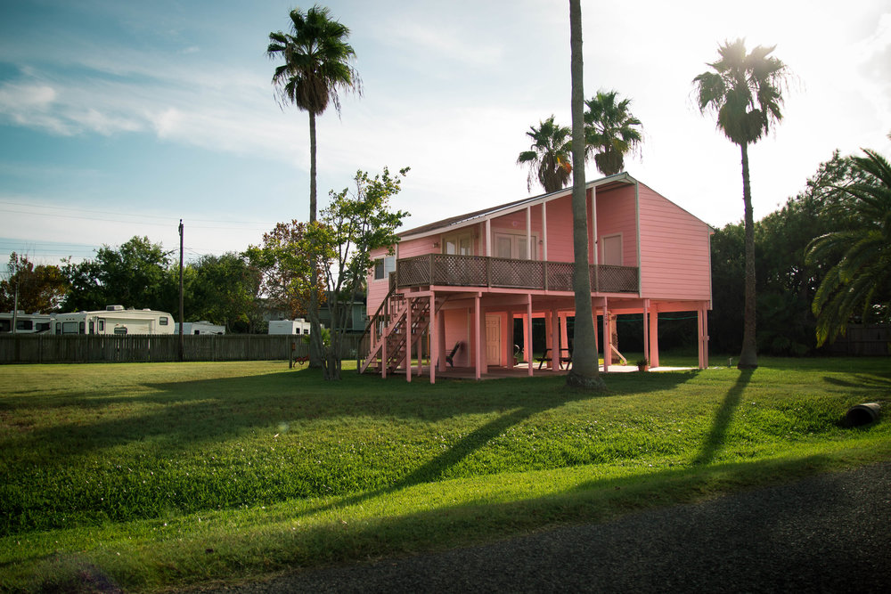 pink house with palm trees in rural rockport texas