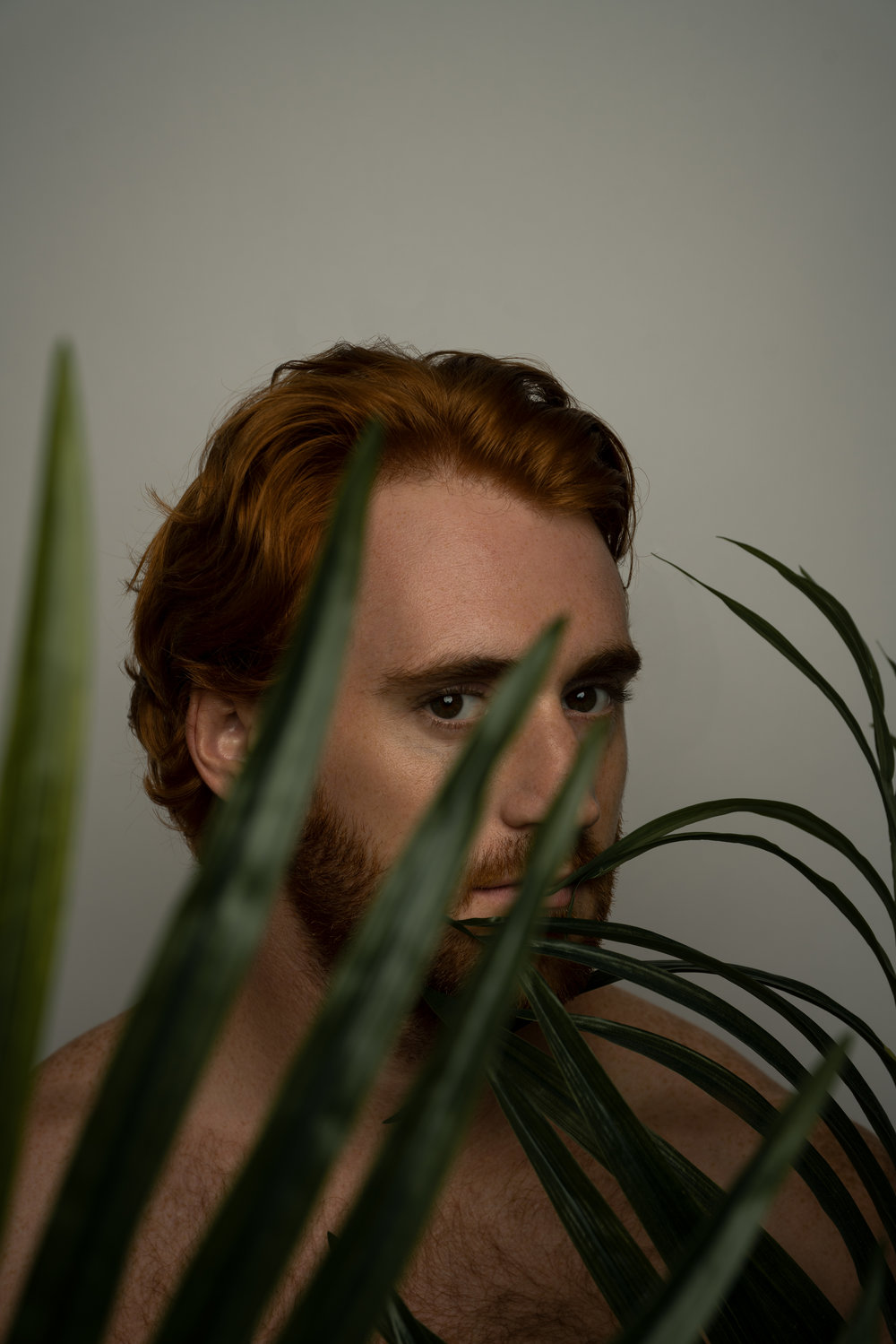 red head green plant portrait