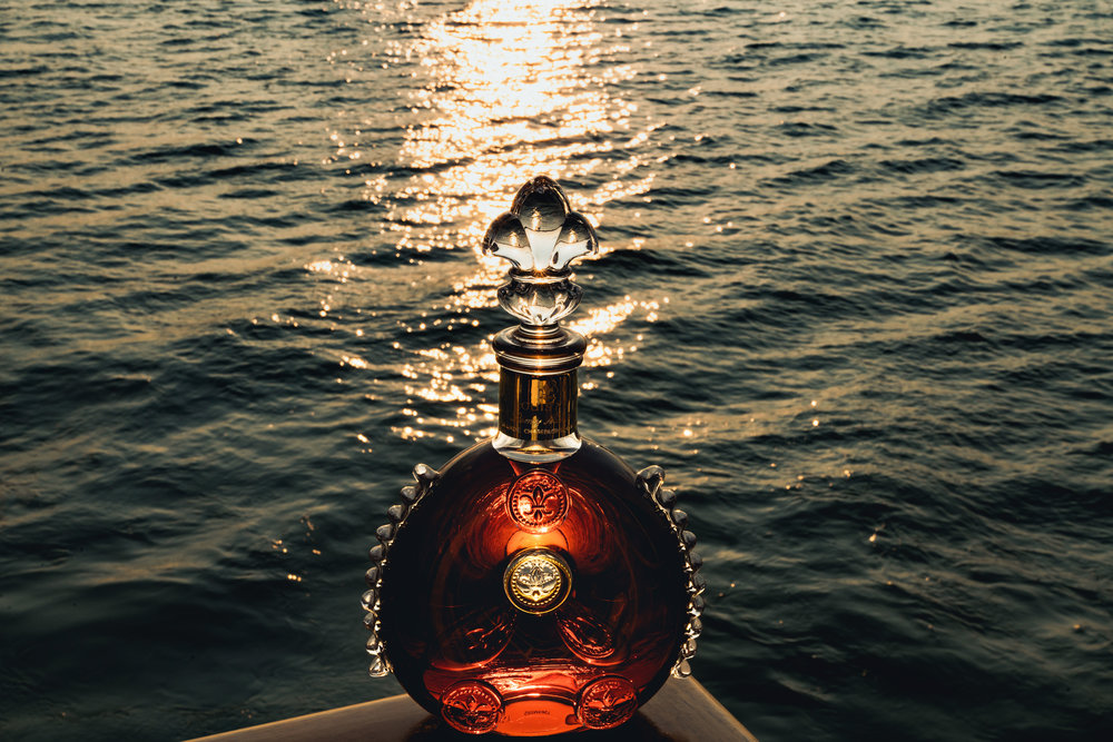 Remy Cointreau louis xiii sun set over water