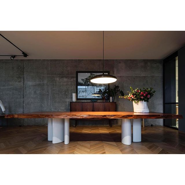 Regal table with the warmth of ancient Kauri wood, custom designed for our project with @claudiaskaff. #kauri wood slab by @yew.studio #lacquered metal legs produced by @acidprojects . #ginosarfatti pendant light for #arteluce. Photo @ieva.saudargaite. #mariagroup_architects #interiordesign #food #feast #wood #beirut #lebanon #bespoke #vintage #woodfloor #pointdehongrie #concretewall