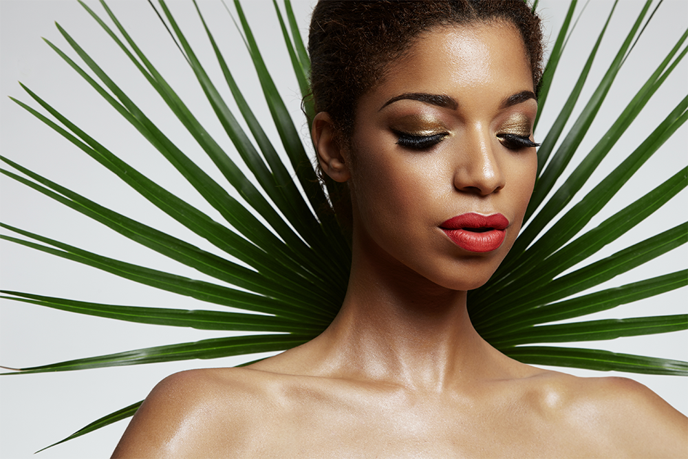 pretty afro woman with a palm leave backside.png
