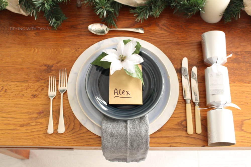 Christmas plate and silverwear setting on dinning table.png
