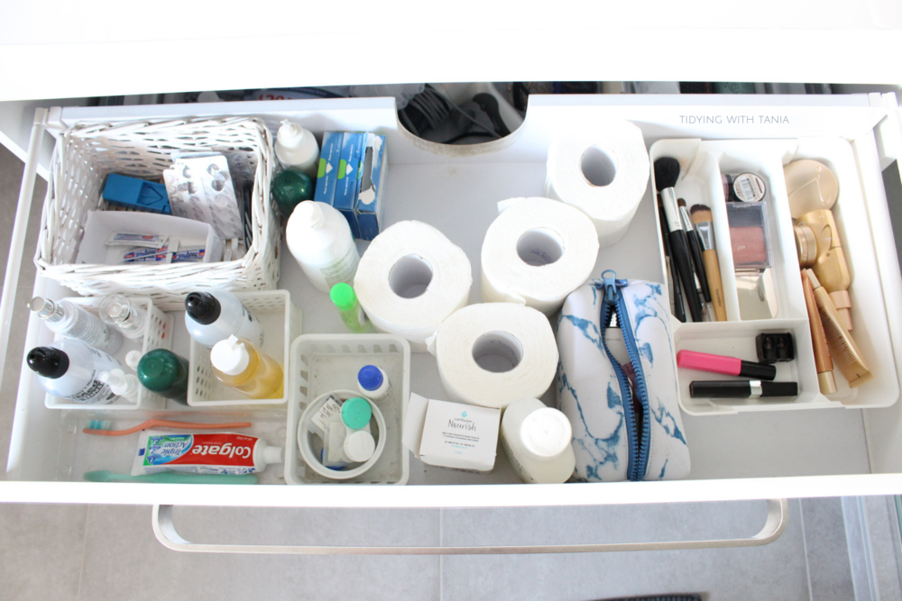 Bathroom drawer open and cluttered.png