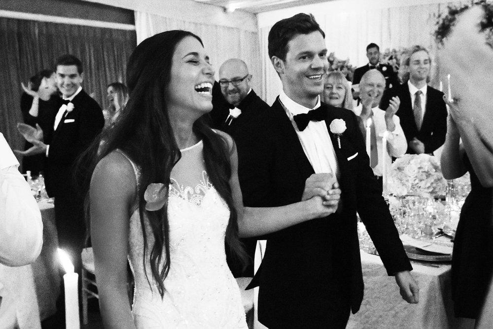 The happy couple entering the wedding breakfast
