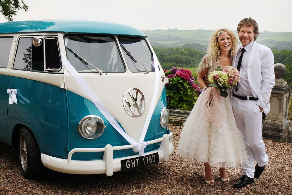 Bride with brother next to split screen camper