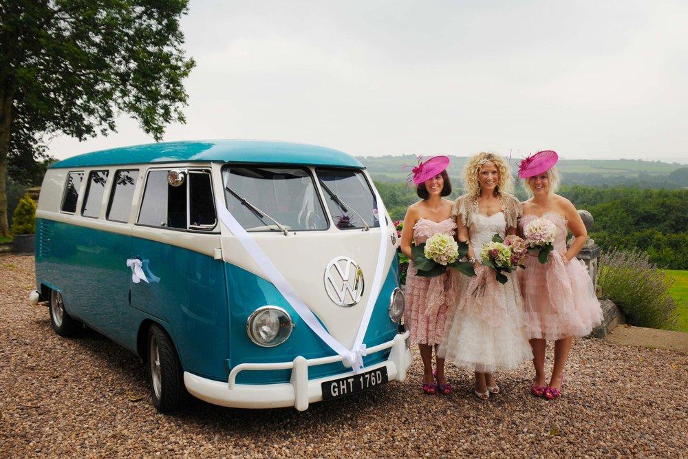 Bride with bridesmaids next to split screen camper van