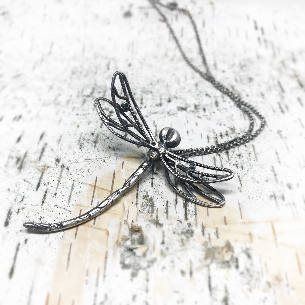 Lifesize dragonfly pendant with diamonds.