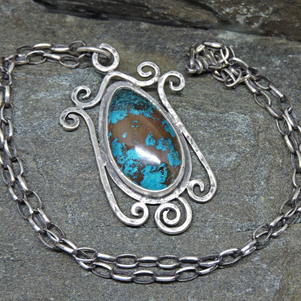 """Wrought Iron"" style scrollwork pendant with chrysocolla."