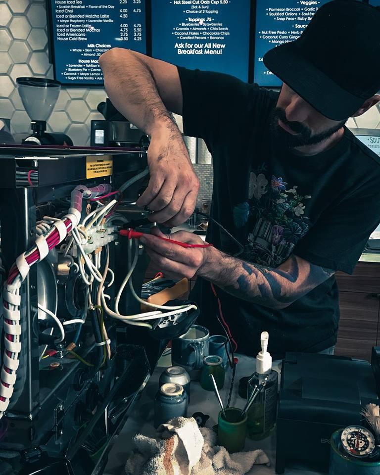 Matt Fixing Espresso Machine.jpg