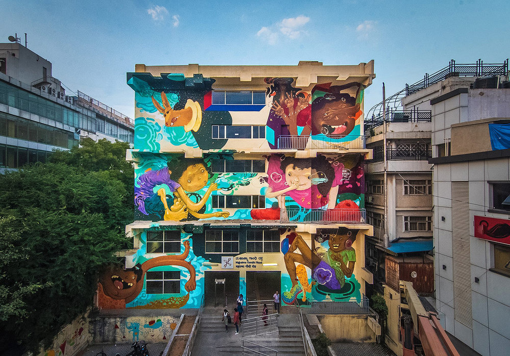 Inkbrushnme's three-storey mural for the MG Road Metro Station, photo by Akshat Nauriyal