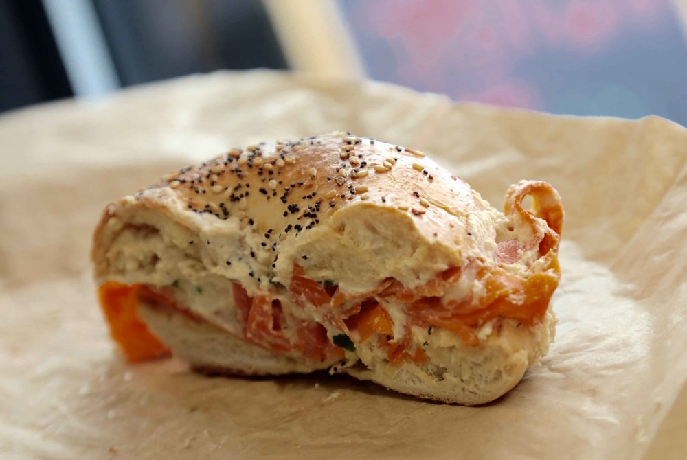 """The """"Edith"""" sandwich with housemade cashew cream cheese, capers, chives and carrot lox on your choice of bagel."""