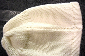 This seam is flat but not as invisible as Mattress stitch.