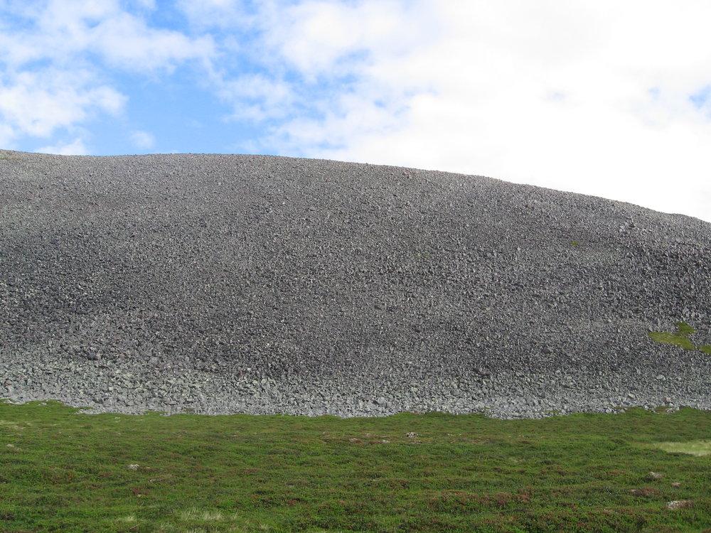 A pile of stones near the coastline.