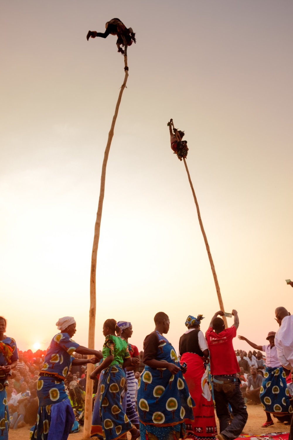 The crowd surrounded the poles and danced as the masked dancers swung above them!