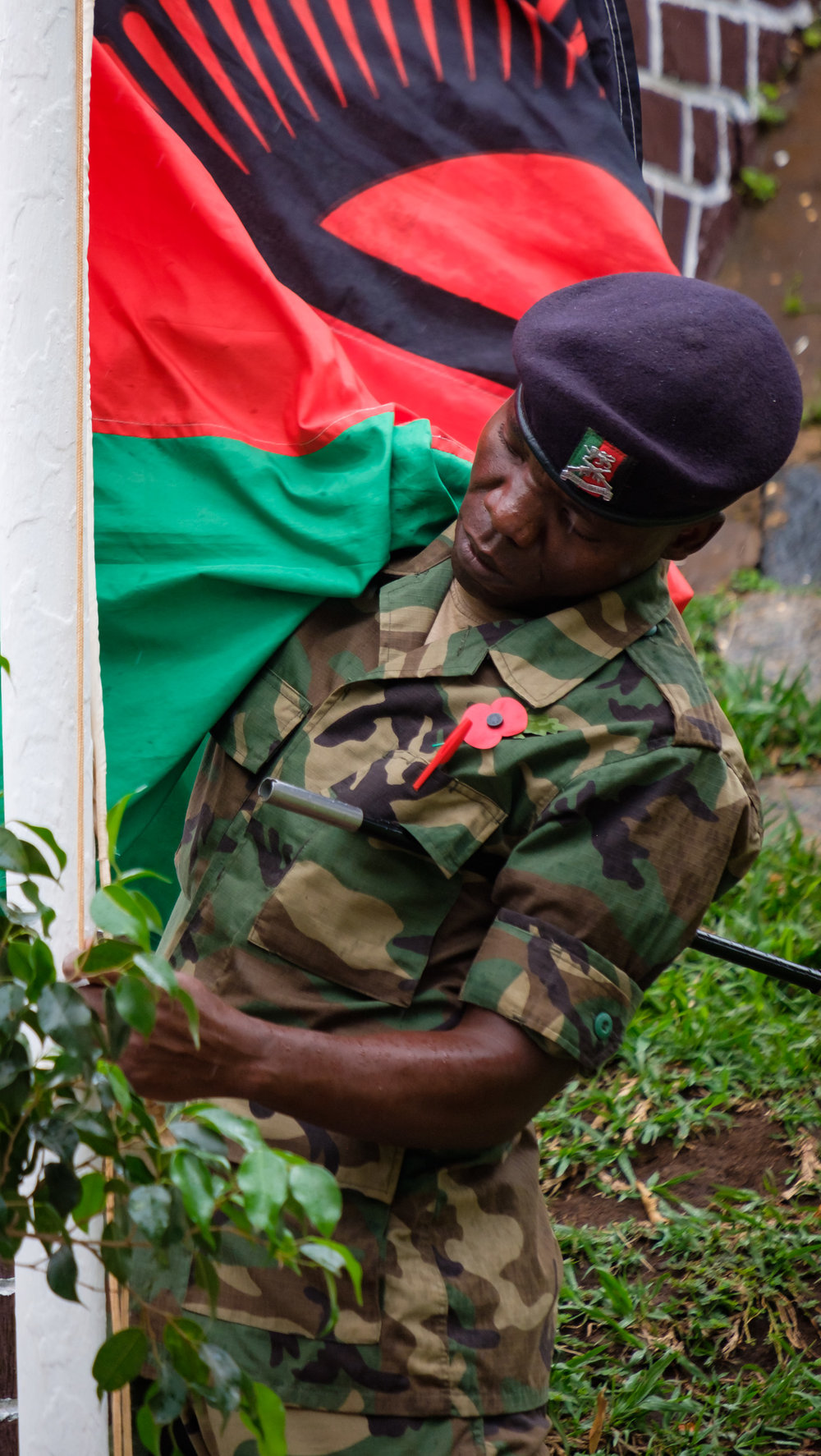 A Solider raises the Malawi Flag before the start of the ceremony.