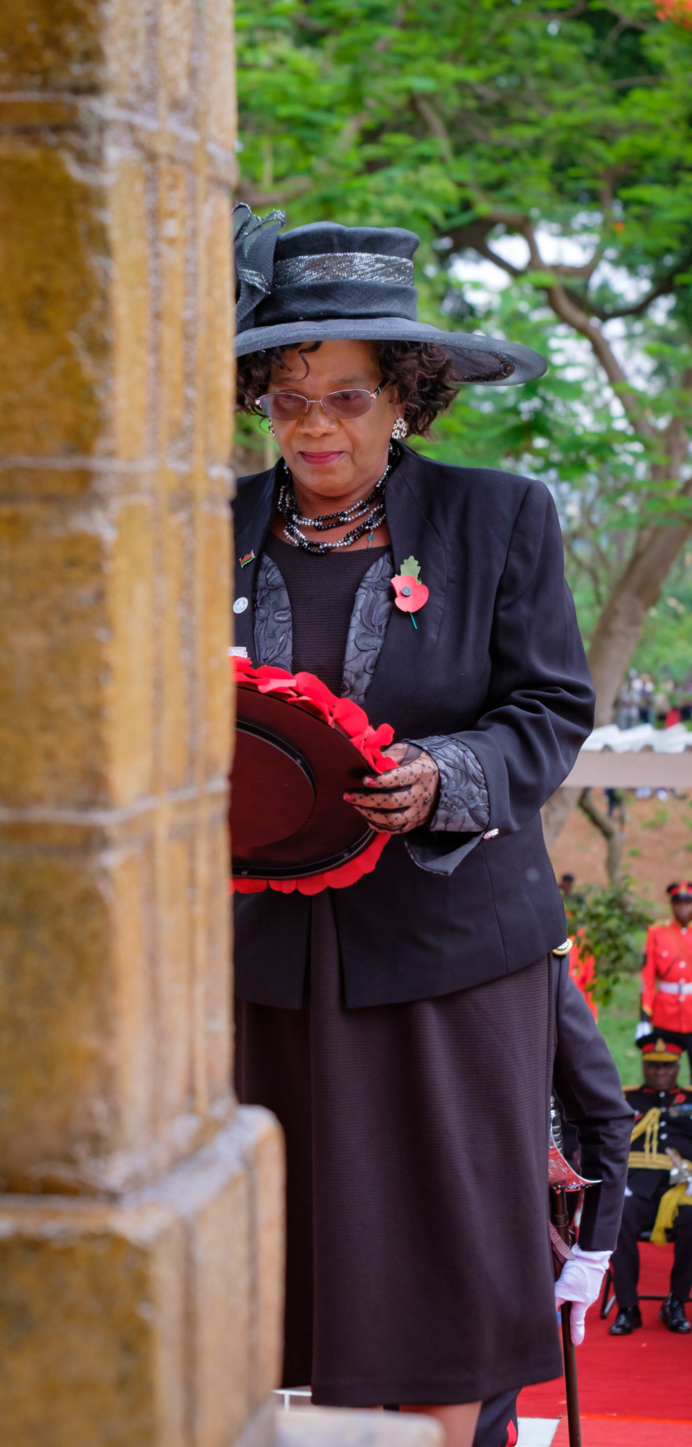 The areas member of parliament laying a wreath.