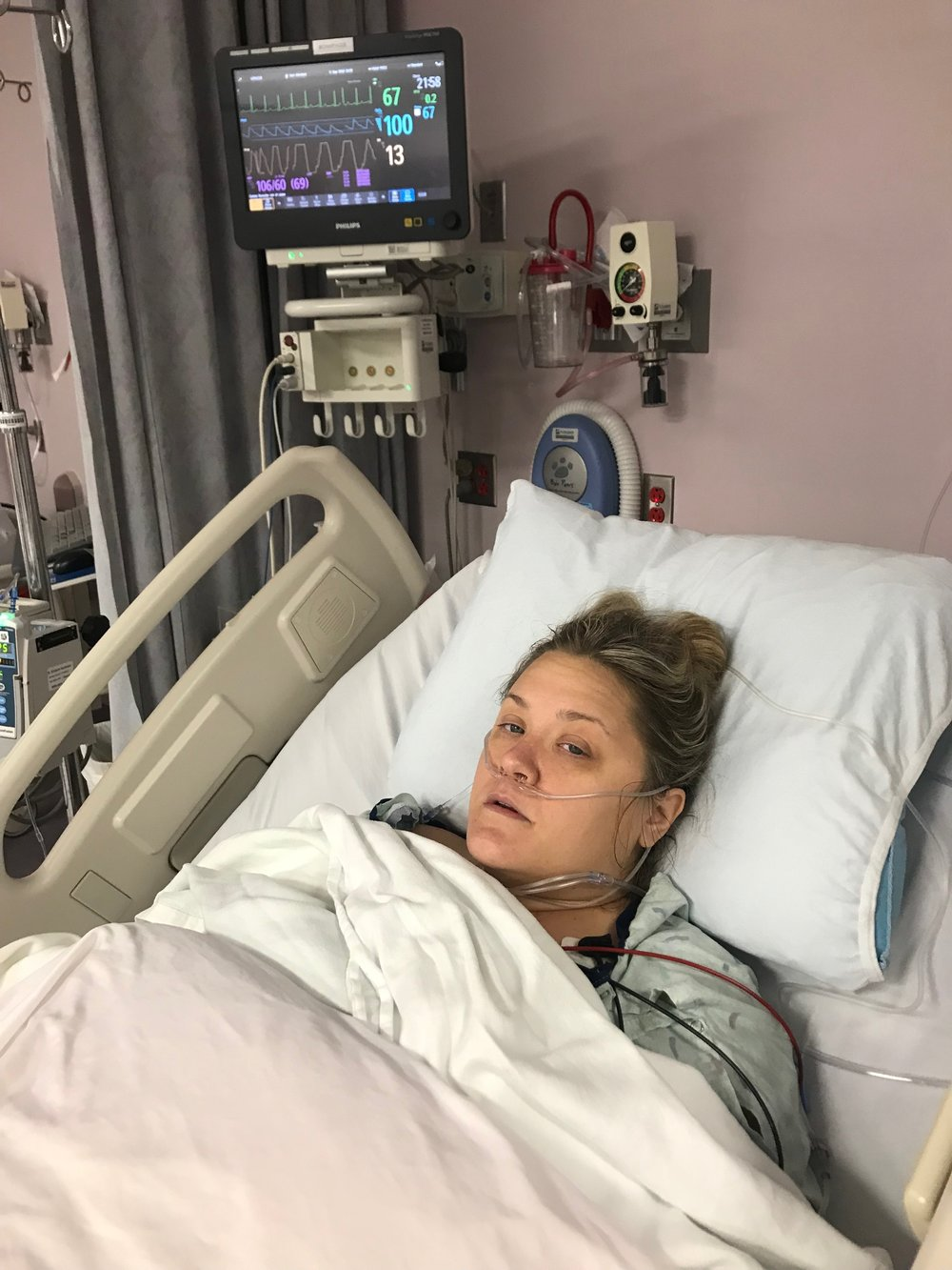 This is me moments after rousing in the post-op recovery room. I guess I was demanding that I wanted a photo. I still wasn't breathing on my own properly and Jordan said my lips kept turning blue. I was only in recovery for about 40 minutes before I went back to my room for the night.