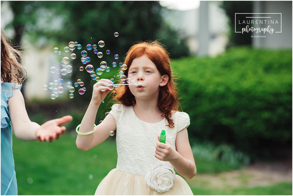 Redhead blowing bubbles Bahai Wedding Briar Patch Bed and Breakfast