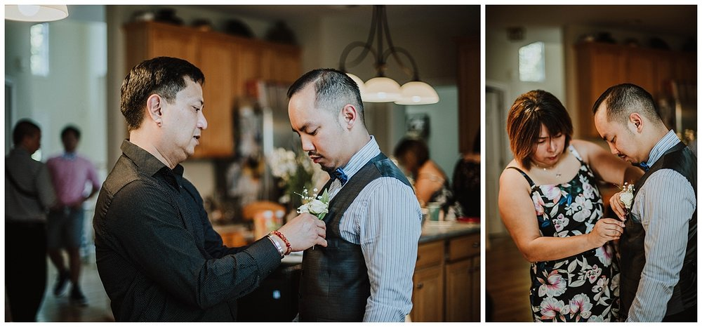 getting-ready-groom-pinning-flowers-fairfax.jpg