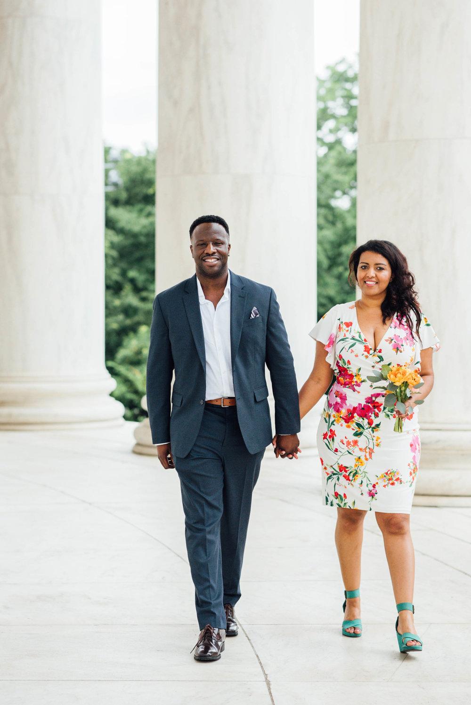 African Couple walking hand in hand inside Jefferson Memorial DC