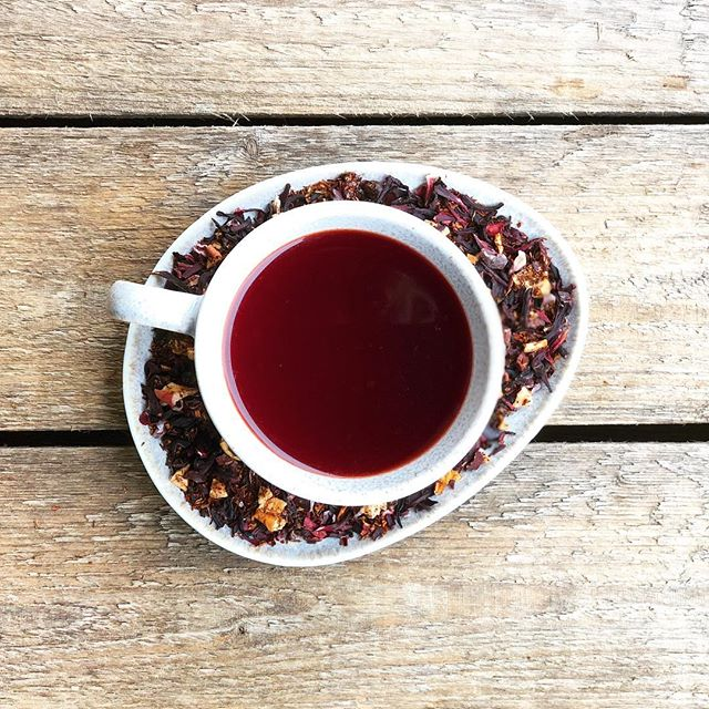 "We think a warm cup is just the thing on a rainy afternoon ☂️so we are brewing our newest tisane ""Take It Easy"" made with rooibos, hibiscus, apple and vanilla!  Plus, I really can't take one more minute outside with the monster mosquitos! Is anyone else being eaten alive?  You can pick up a calming tin of this new caffeine-free blend from us or visit Le Petit Café at the farmers market where the lovely Miss Deirdre is brewing Gardenaire teas to order. . . . #takeiteasy #tisane #tea #hibiscustea #rooibos #apple #vanilla #foodie #madeinminnesota #rochmn  #farmersmarket #drinklocal"