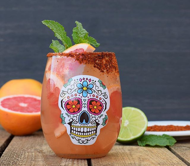 "Día de los muertos is a festive holiday filled with brilliant colors and a joy for life.  We created a special cocktail, (a twist on a #paloma ) so we can raise a glass to celebrate and honor our friends and family. Here's the recipe so you can enjoy this drink at your own #dayofthedead party!  Salud! . . In Good Spirits 2oz mezcal 3oz fresh grapefruit juice 1/4 oz fresh lime juice 3/4 oz Gardenaire ""The Bitter End"" syrup Club soda Chile + sugar + salt (for rim) Grapefruit and/or mint to garnish . . 1. Mix Chile powder, sugar and salt (I used a 1:2:1 ratio). Cut lime and use to rim glass with chile mix. 2. Add mezcal, grapefruit juice, lime juice and syrup to a shaker with ice and shake to combine. 3. Strain into a glass with fresh ice. 4. Top with club soda, garnish and serve!"