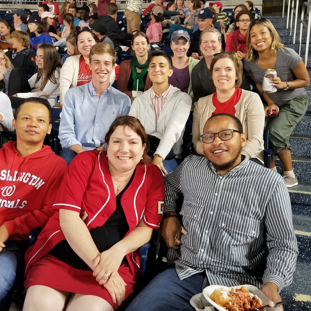 Team members chose to attend either a baseball game (pictured), an orchestra concert, or a play.