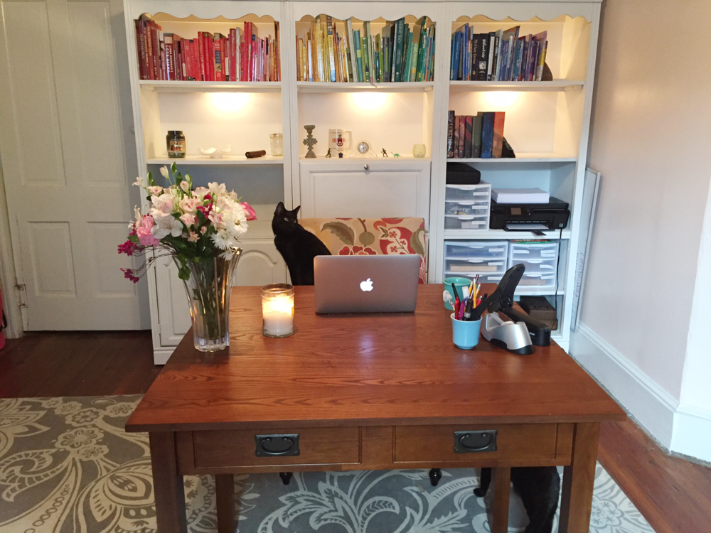 Clyde the cat commandeers a team member's home office as she pours another cup of coffee.