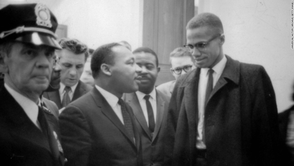 King speaks to Malcolm X at a press conference on March 26, 1964.