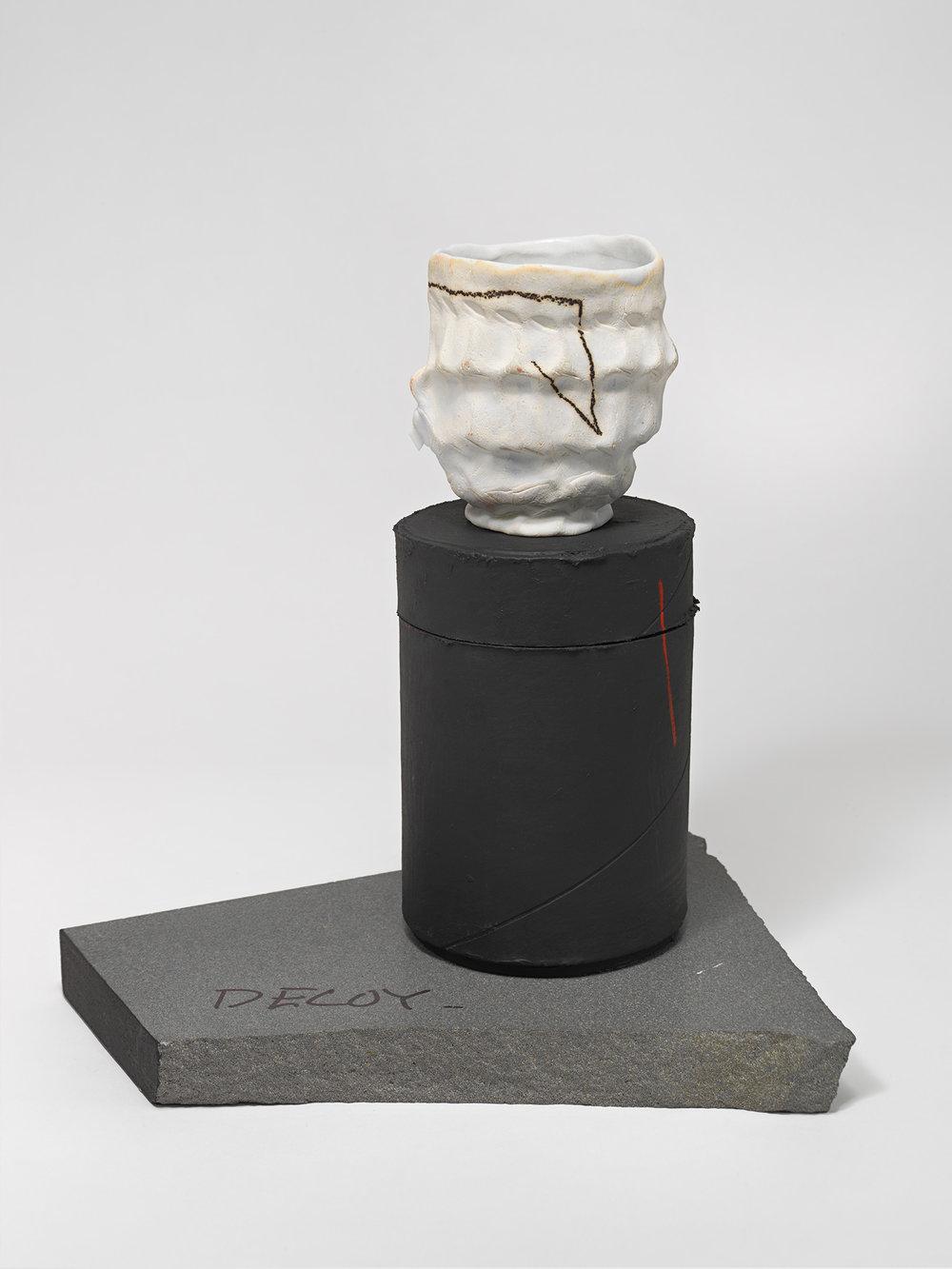 """DECOY_Cup_7 . Porcelain, porcelain blade, cardboard, granite. 10"""" x 9"""" x 7"""". 2014."""