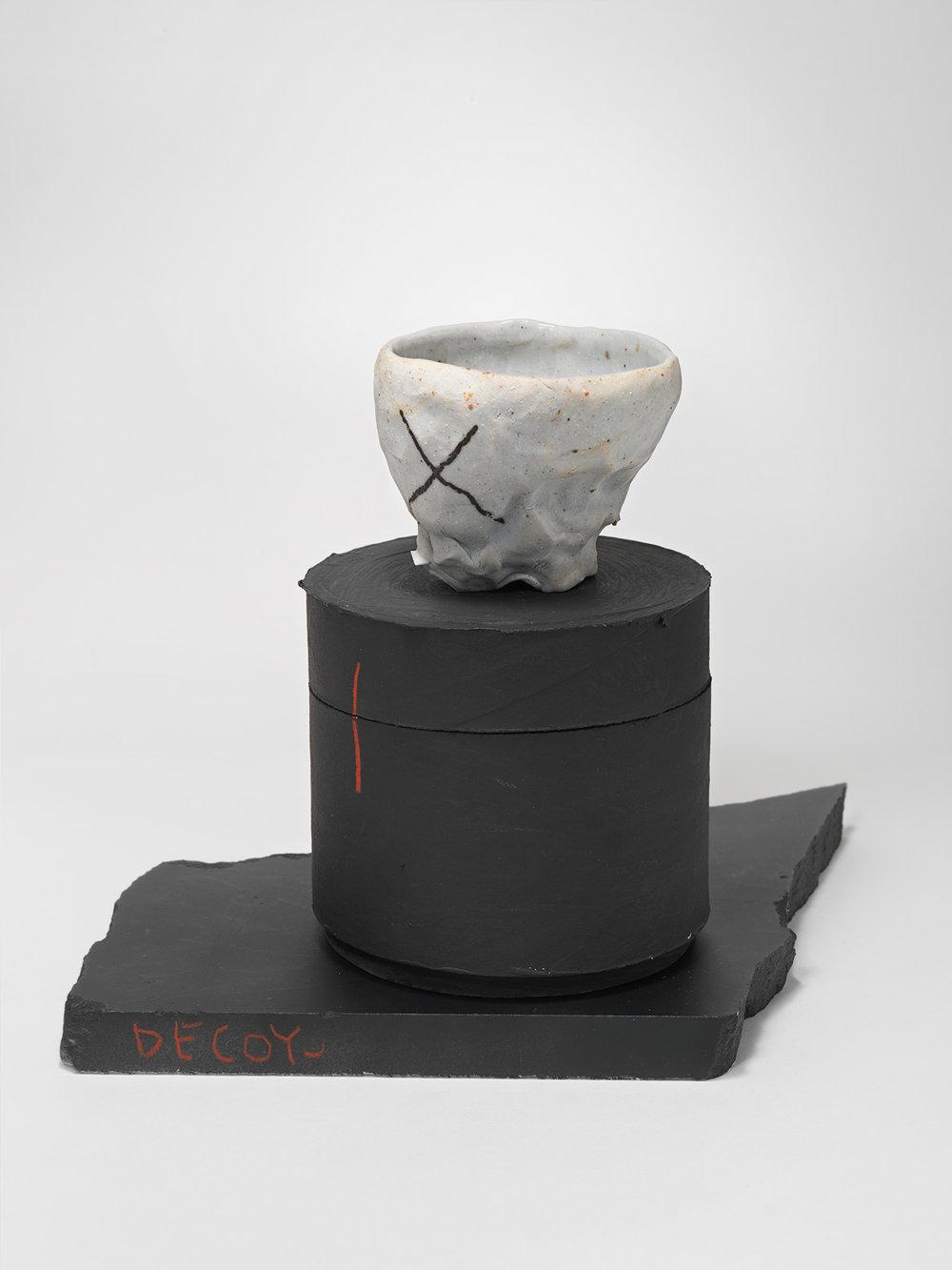 "DECOY_Cup_6 . Porcelain, cardboard, granite. 8.5"" x 9"" x 8.5"". 2014."