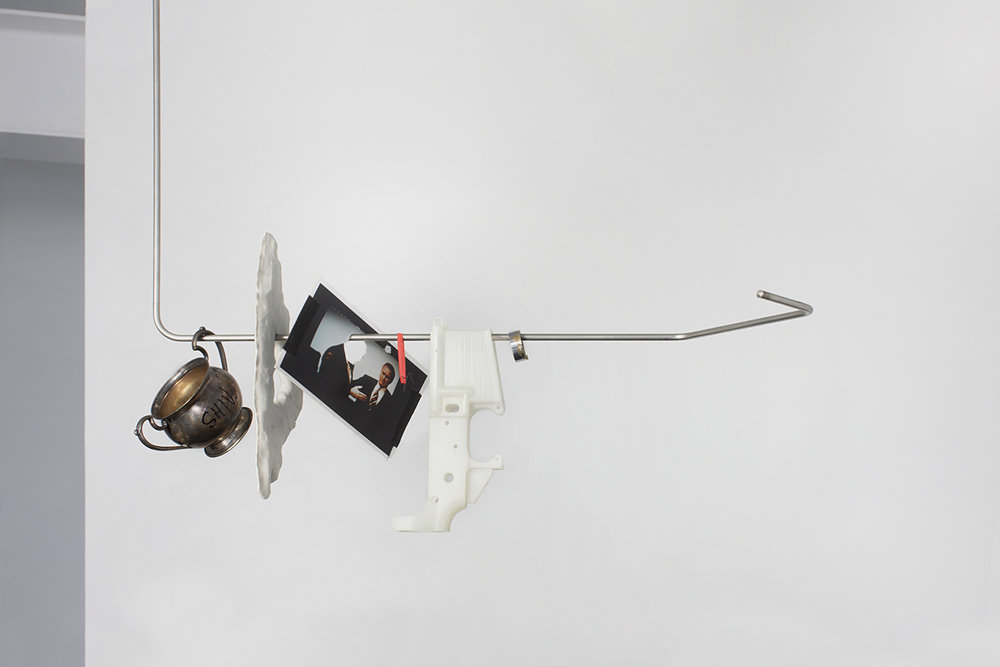 "ShiV_Rack (Left) . Brass, plastic, paper, eyebrow hair, notecard, porcelain, sterling silver, stainless steel. 74"" x 26""x 6"". 2012."