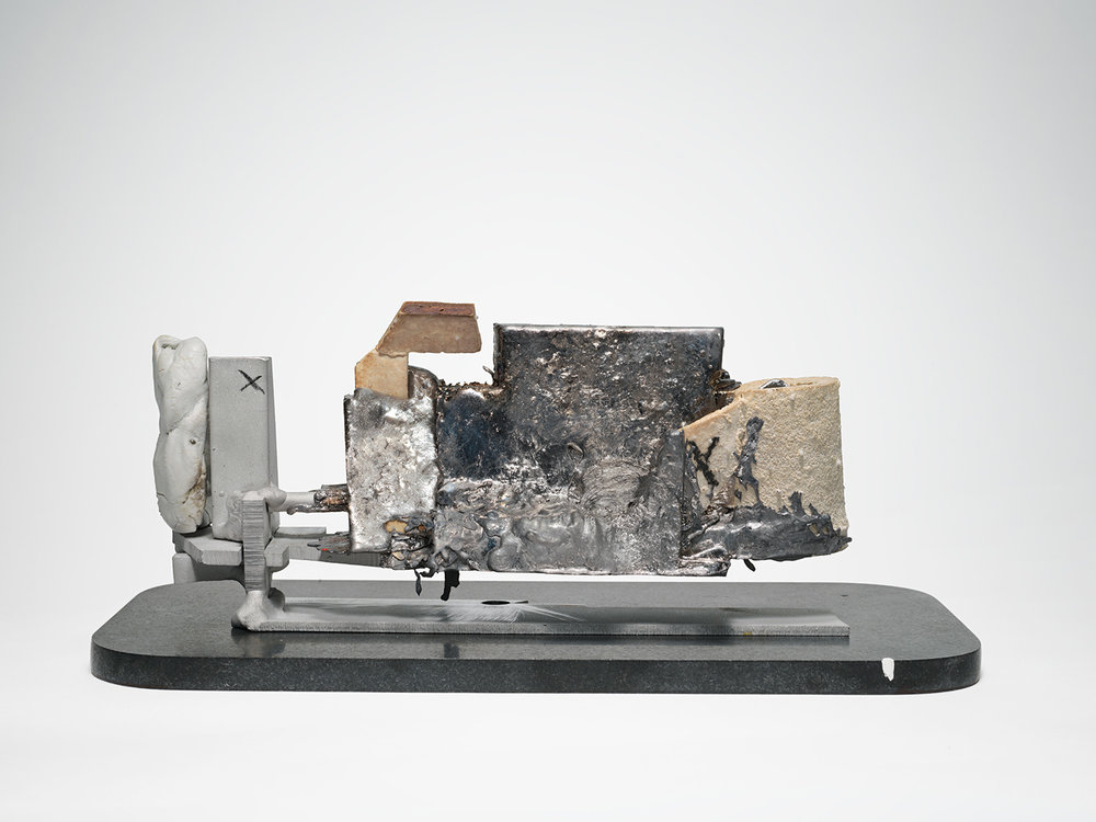 "GHOST_VIEWER . Porcelain, lead, aluminum, granite. 4.25"" x 12"" x 5"". 2014."