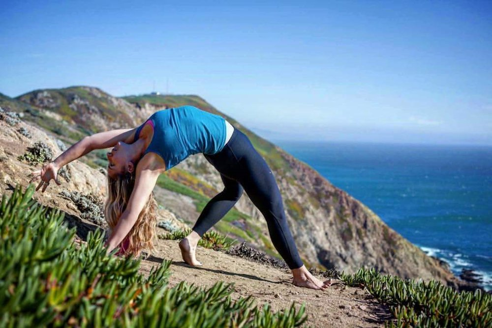 Marina Guastucci    Marina is a life-long Bay Area resident, yogini mama and lover of all that is wild. Her classes, workshops and retreats invite students to explore the details of all experiences with the utmost passion and curiosity. For Marina, yoga asana is an embodied ritual which has the capacity to uncover our most vibrant, potent selves. Her slow moving vinyasa classes are alignment-rich, highly creative, and meant to honor and celebrate each student's unique connection to yoga. Her teachings integrate elements of somatic movement, follow the rhythms of nature and include various meditation and pranayama techniques and ritual. Her major influences have been Rod Stryker, Bryan Kest and more currently Abby Tucker, with whom she's studied extensively. Before yoga found Marina, she received her BA in Ethnic Studies from UC Berkeley, where her continued passion for social justice blossomed. Her day to day life is spent mostly at home rearranging furniture for fun, in the woods collecting leaves with her tiny human, mountain biking, and gardening. Join her in enlivening your senses through yoga, travel, connection, knowledge and play!