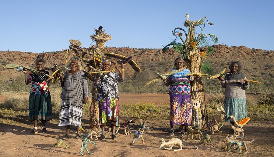 apy lands artist/tjanpi desert weavers collaboration   punu kutjara - two trees  2016. L- R Mary katajuku pan, illawanti ungkutjuru ken, tjunkaya tapaya, Imiyari frank,niningka lewis. copyright tjanpi desert weavers, npy women's council