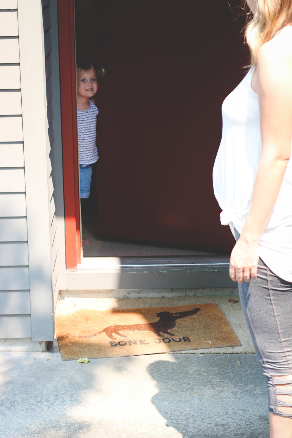 "Madelyn didn't want to endure the hot weather so she opted to stay inside during the photos, but she kept opening the door and making sure we ""okay?"""