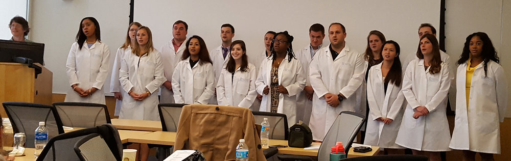 our 16 new m&i students recite their graduate student oath