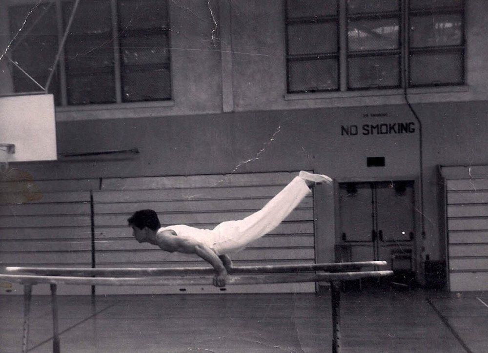 Rodriguez on the parallel bars at Excelsior High School just before winning the CIF championship in gymnastics.