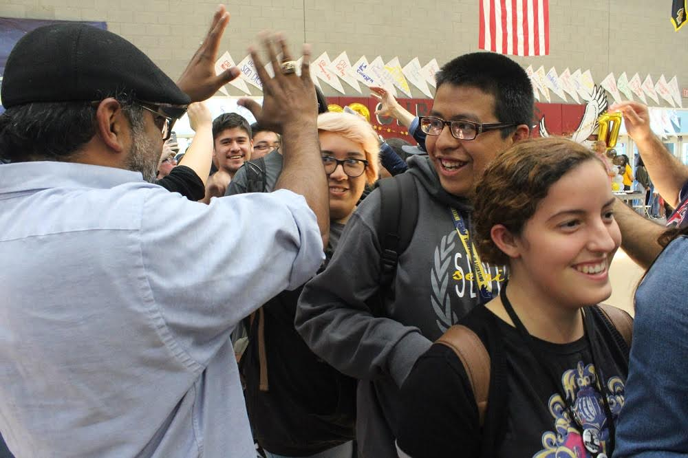 Firebaugh High seniors were cheered as they entered the auditorium through teacher- and staff-made tunnels on May 18 as part of Senior Signing Day.   Photo | LUSD